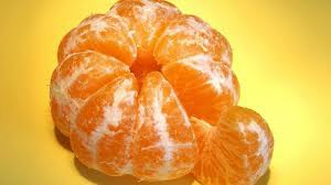 Peeled orange showing a slice is fraction 1/8 of whole.