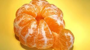 Peeled orange showing a slice is fraction 1/8 of whole.